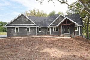 Custom home with dark LP siding and white trim