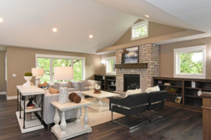 Spacious family room with gas fireplace and custom built-ins