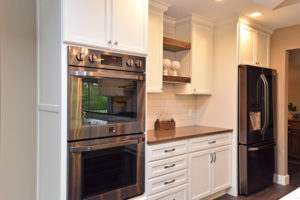 Custom home kitchen with wood and painted cabinets