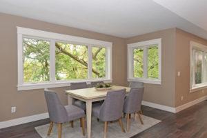 Custom home dining room overlooking wooded yard