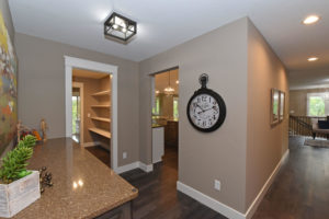 Custom home with warm tones and white trim