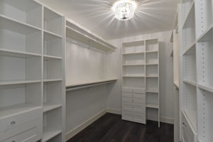 Spacious walk-in master closet with plenty of storage space