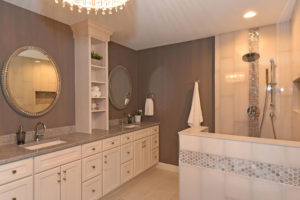 White cabinets and warm brown tones in master bathroom