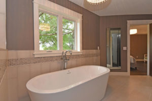 Serene master bathroom with freestanding bathtub