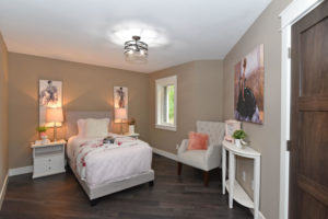 Bedroom with white trim and warm tones