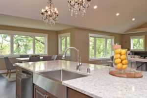 Cambria quartz island countertop with stainless steel farm sink