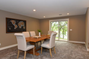 Basement with warm brown tones and white trim